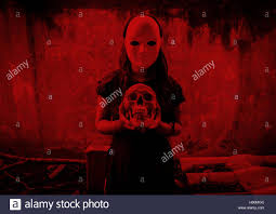 Mysterious Woman Wearing White Mask With Skull In Hand Scary Stock