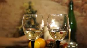 friends wine toasting clinking wine glasses sophisticated