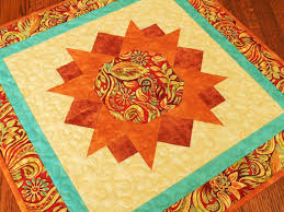quilted square table toppers quilted square table topper with orange rust and blue swirls and