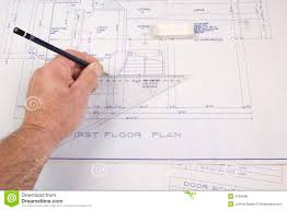architect drawing up plans for a house royalty free stock image