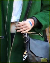 emma stone draws french flag on her hand to support paris photo