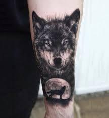 black n grey wolf on forearm