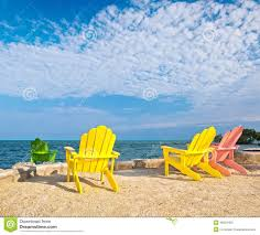 Summer Lounge Chairs Yellow And Pink Colorful Lounge Chairs On A Beach In Florida Stock