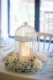 used wedding centerpieces birdcage wedding centerpiece our flowers