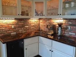 brick backsplash kitchen black countertop and brick backsplash kitchen with glass cabinet