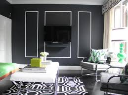 geometric printed rug with elegant black accent wall for superb