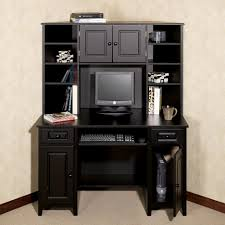 big black wooden desk integrated with upper section storage