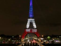 The Eiffel Tower by Eiffel Tower Lit Up Blue White And Red In Honor Of Paris Attack