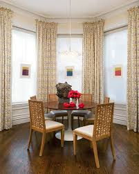 grey and yellow curtains dining room transitional with bust