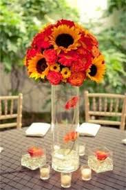 Centerpieces With Sunflowers by The Bascom Rehearsal Dinner By Olivia Griffin Photography Walton