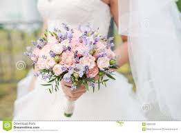 wedding flowers lavender wedding bouquet of lavender roses and peonies stock photo