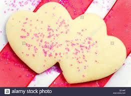 heart shaped cookies heart shaped sugar cookies and pink sugar sprinkles with