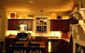 above kitchen cabinet decor ideas ideas for above kitchen cabinets 1 put some baskets up there and