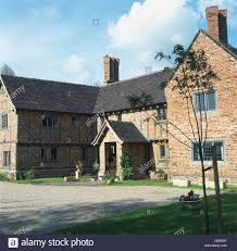large new build tudor style country house with brick timber
