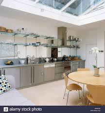 where to buy glass shelves for kitchen cabinets glass shelving above stainless steel fitted units in modern