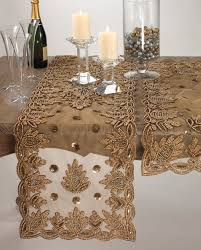 gold lace table runner on rectangle wood wedding table with