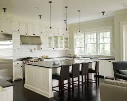 black granite countertops white kitchen cabinets granite versus quartz what is right for your home home