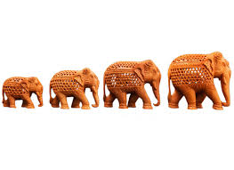carved wooden elephant figurines