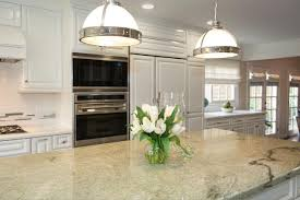 kitchen lighting fixtures over island pretty white flower on tiny glass vas above grey motif marble