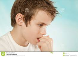 thoughtful worried young boy biting his nails stock photo image