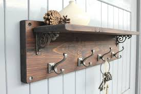 furniture brown wooden coat hanger and rack with bronze hook and