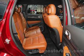 orange jeep grand cherokee jeep grand cherokee srt rear seat at auto expo 2016 indian autos