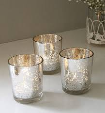 set of two silvered tea light holders by lilly