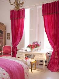 cozy bedroom with bright pink quilt and pink curtain dweef com