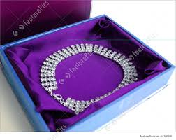 diamond box necklace images Fashion accessories closeup of diamond necklace on a blue box jpg