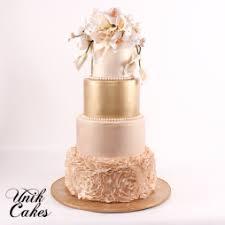 wedding cake gold unik cakes wedding speciality cakes pastry shop