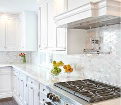 carrara marble kitchen backsplash white kitchen cabinets with oblong marble tiles transitional