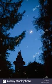 moonrise over a hotel building in flims switzerland stock photo