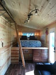 a 240 square feet tiny house built on a 5th wheels goose neck
