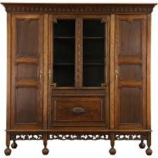 Antique Revolving Bookcase Dutch Hand Carved Oak 1910 Antique Bookcase Wavy Glass Doors From
