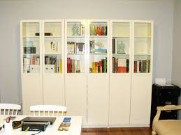 furniture home built in white bookcaseshelves around doorway