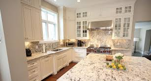 granite countertop white shaker cabinet doors backsplash mosaic
