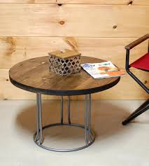 reclaimed wood round coffee table with steel base features