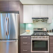 white kitchen cabinets and black stainless steel appliances the pros and cons of stainless steel appliances in the kitchen