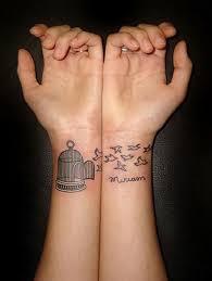 attractive flying black birds wrist tattoos