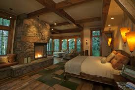brave log cabin master bedroom design with stacked stone fireplace