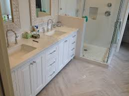 all white bathroom marble counter herringbone tile remodel hauser