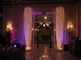 lake terrace dining room light columns with white satin fabric at the broadmoor lake