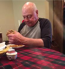 papaw eating a hamburger alone Wait But Why