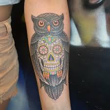 an assortment of owl tattoos artists