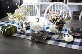 white painted dining room chairs and a white pumpkin centerpiece