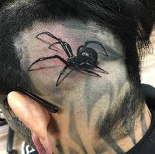 spider by jims ink at art driven tattoo shop in los angeles