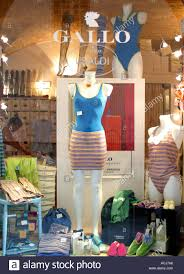 clothes shop in bologna italy with womens clothes stock photo