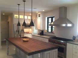 large kitchen island with butcher block top and corner sink under