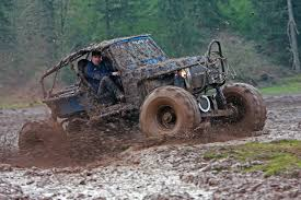 mudding truck warn industries photo of the week mud slinging suzuki