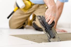 Concrete Floor Sweeping Compound by How To Install Ceramic Floor Tile On Concrete Diy Tips